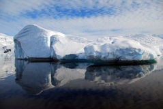 Oval iceberg with reflection. In water Royalty Free Stock Photo