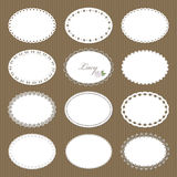 Oval lacy doilies big set on cardboard background. Royalty Free Stock Image