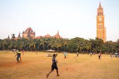Oval Maidan Mumbai. MUMBAI, INDIA - November 5 2017: Locals play cricket on the famous Oval Maidan recreational ground on a hot summer`s day in Mumbai, India Royalty Free Stock Image
