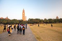 Oval Maidan Mumbai. MUMBAI, INDIA - November 5 2017: Locals play cricket on the famous Oval Maidan recreational ground on a hot summer`s day in Mumbai, India Stock Photography