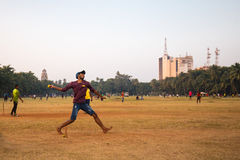 Oval Maidan Mumbai. MUMBAI, INDIA - November 5 2017: Locals play cricket on the famous Oval Maidan recreational ground on a hot summer`s day in Mumbai, India Stock Photo