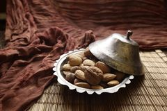 A container of almonds stock photo