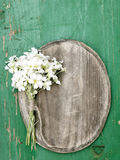 Oval plaque and a flowers bouquet Royalty Free Stock Photography