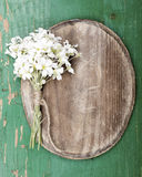 Oval plaque and a flowers bouquet Royalty Free Stock Image
