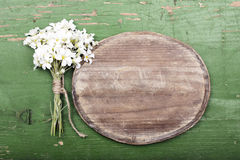 Oval plaque and a flowers bouquet Royalty Free Stock Images