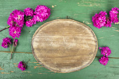 Oval plaque and pink flowers Royalty Free Stock Photos