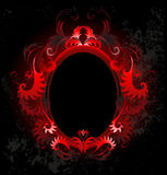 Oval red banner. Patterned, red, oval banner on a black background Stock Photo