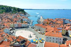 View of Piran, Slovenia. Oval-shaped main Tartini square,old stone houses, narrow streets, port and small boats in Piran, Slovenia stock photography