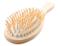 Oval shaped wooden hairbrush Stock Photography