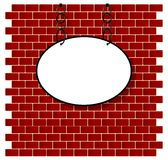 Oval sign on bricks wall Royalty Free Stock Photos