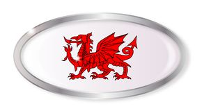 Welsh Dragon Oval Button. Oval silver button with the Welsh dragon isolated on a white background Stock Photo