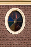 Oval Stained Glass on a Gingerbread Cottage Royalty Free Stock Images