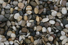 Oval stone background. Traditional way of filing the space in irish gardens Royalty Free Stock Photo