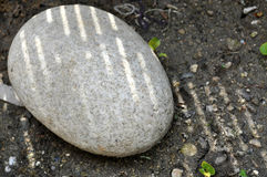 Oval stone on ground Stock Photography