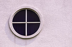 An oval window on cement wall Royalty Free Stock Images