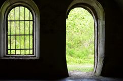 The oval window and the entrance to the old fortress stock photos