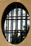 Oval window with grille Royalty Free Stock Photos