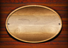 Oval Wood Board on Wall Royalty Free Stock Photos