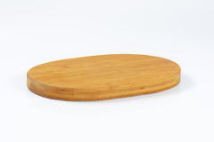 Oval wooden cheese board Stock Image