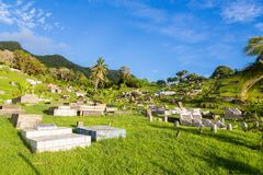 Ovalau, Fiji. Hillside cemetery with summer lush green lawns, palms, blue sky and old gravestones, Ovalau island, Fiji, Melanesia. stock photo