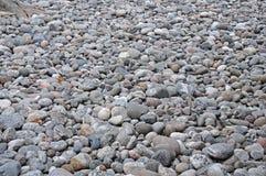 Ovale die stenen op een vlakke oppervlakte worden gelegd stock afbeeldingen