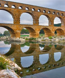 Ovals and semicircles. The well-known antique bridge-aqueduct Pont du Gard in Provence Royalty Free Stock Image
