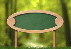 Ovalt grönt svart tavlatecken med skogbakgrund royaltyfria bilder
