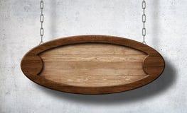 Ovalt trätecken som hänger på kedjor med betongväggbakgrund royaltyfri bild