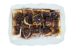 Ovaltine toast with butter and sweetened condensed milk. In paper box on white background stock photos