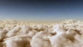 Ovanför fluffiga moln Royaltyfri Fotografi