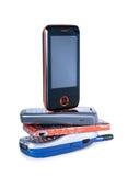 ovanför mobila nya gammala telefontelefoner Arkivfoton