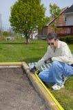 ovanför trädgårds- jordning Arkivfoto
