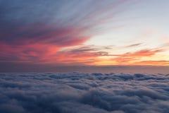 Ovannämnda moln för solnedgång Royaltyfria Bilder