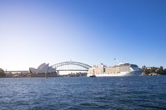 The Ovation of the Seas, the biggest cruise ship based in Australia, sails on harbour in front of Opera house and Harbour bridge. In Sydney. Australia:08/02/18 stock photography