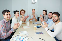 Ovations to spokesperson. Business people clapping hands after successful presentation Stock Images