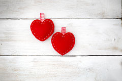 Ove couple. Two red hearts lie on the white wooden background Royalty Free Stock Photo