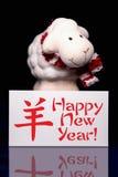 Ovejas con la tarjeta de felicitación del Año Nuevo Imagenes de archivo