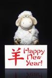 Ovejas con la tarjeta de felicitación del Año Nuevo Foto de archivo libre de regalías