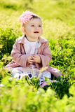 Ovely baby in green grass Royalty Free Stock Photo