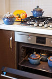 Oven. Cooking in oven, blue pots for food Stock Photography