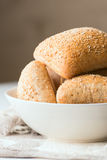 Oven baked bread in bowl vertical close up Stock Photography
