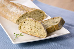 Oven baked bread with thyme. On white plate Royalty Free Stock Photography