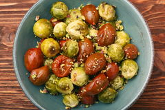 Oven baked brussels sprouts and tomatoes with pistachios Royalty Free Stock Image