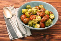 Oven baked brussels sprouts and tomatoes with pistachios Royalty Free Stock Photos