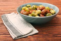 Oven baked brussels sprouts and tomatoes with pistachios Royalty Free Stock Photo