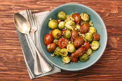 Oven baked brussels sprouts and tomatoes with pistachios Stock Image
