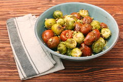 Oven baked brussels sprouts and tomatoes with pistachios Royalty Free Stock Photography
