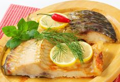 Oven baked carp fillet Stock Photos