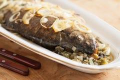Oven baked carp fish Stock Photo