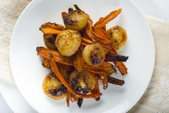 Roasted carrots and onions Royalty Free Stock Image